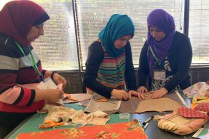 Emerging sewing leaders working on a project