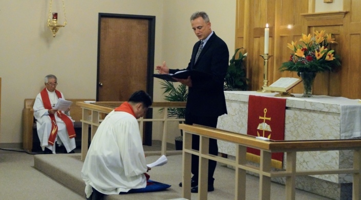 Rev. Greg Beutel (Counselor: Circuit 9 ) blesses Pastor Son. (Rev. Sang Ik Moon also pictured)