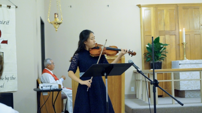 A member of the congratulation worshiped the Lord with music during the offering