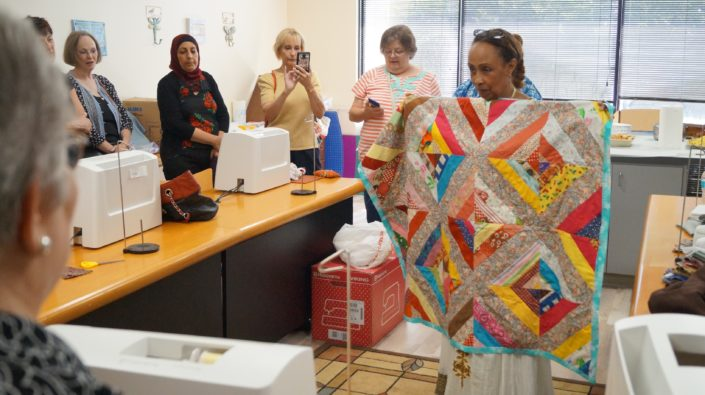 Mulu showing off her quilt.