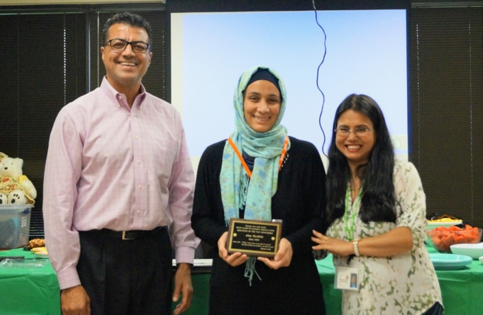 Alaa receives an Outstanding Student Award