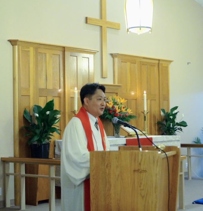 Pastor DongSu Son addresses his congregation